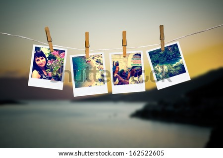 photos of holiday people hanging on clothesline with sea background - stock photo