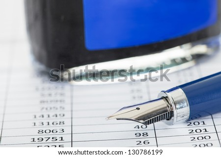 Photos of ink bottle and fountain pen - stock photo