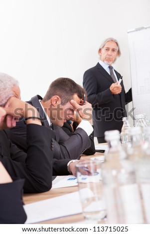 Photos Of Sad Business Team Attending The Seminar - stock photo