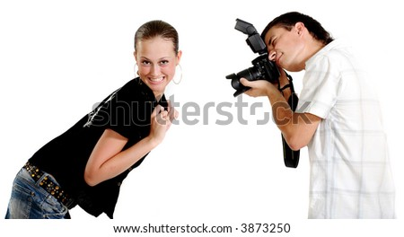 Photosession. A surprised charming girl is sitting to a young photographer. - stock photo