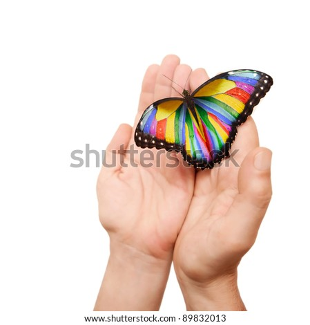 photoshoped butterfly (originally a blue morpho) on a man hands. - stock photo
