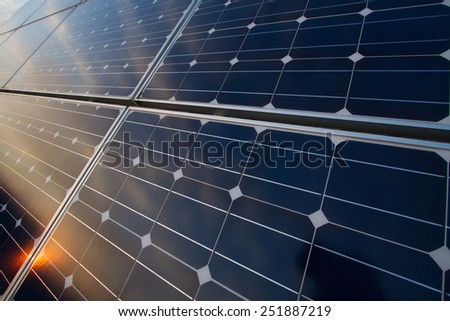 Photovoltaic cells and reflection of sunset light  - stock photo