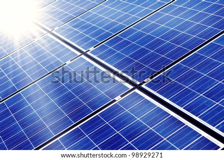 photovoltaic cells and sunlight - stock photo