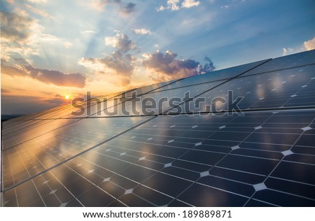 Photovoltaic cells on the background of a sunset - stock photo