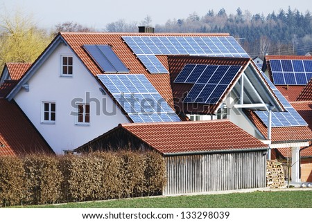 Photovoltaic - Electricity generation with solar panels on the roof - stock photo