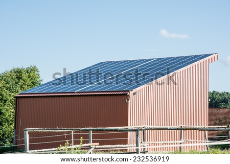 Photovoltaic energy creation with solar panels on the roof - stock photo