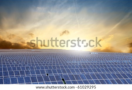 Photovoltaic installation with sunlight on the background - stock photo
