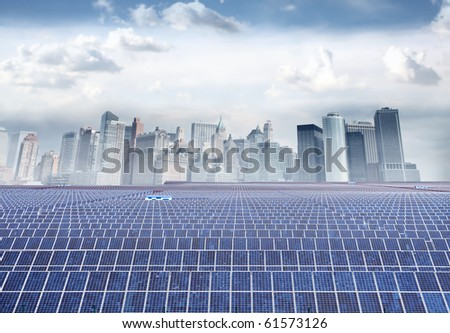 Photovoltaic installations with cityscape on the background - stock photo