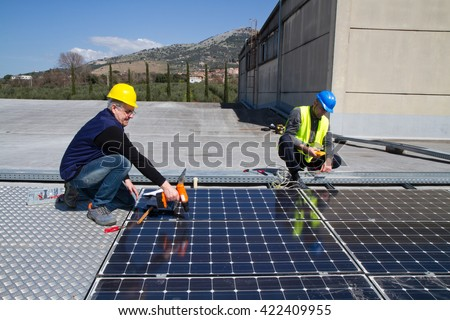 photovoltaic laborers fitting panels