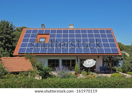 Photovoltaic module on private residential building - stock photo
