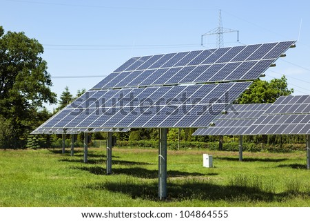 Photovoltaic modules at small solar power station in rural Germany - stock photo