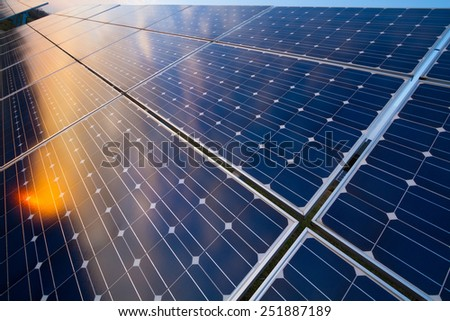 Photovoltaic modules reflect sunset light