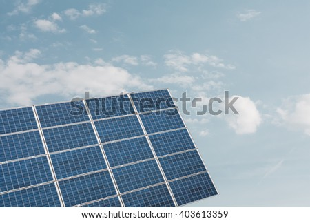 Photovoltaic panel against cloudy sky with copyspace - stock photo