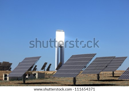 Photovoltaic panels and a tower of a Solar Power Station - stock photo