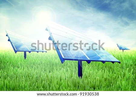 Photovoltaic panels in a green field of grass - stock photo
