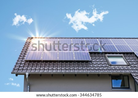 Photovoltaic panels on the roof - stock photo