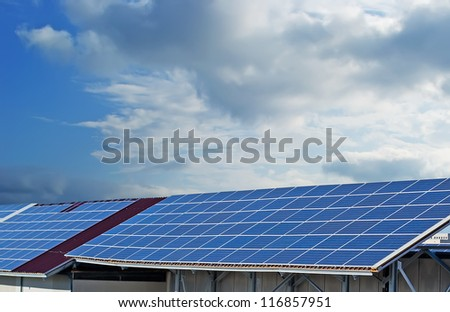 photovoltaic panels under a cloudy sky