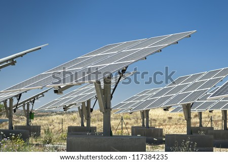 Photovoltaic silicon panels with tilted single axis track system in a small solar power plant, Portugal - stock photo