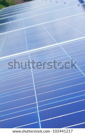 Photovoltaic Solar panel module array on roof of building
