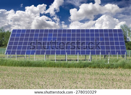 Photovoltaic Solar Panel on the Field - stock photo