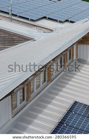 photovoltaic solar panels atop roof of ecology center in milwaukee wisconsin - stock photo