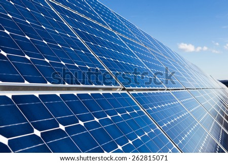 Photovoltaic solar panels blue background - stock photo
