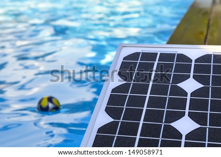 photovoltaic solar panels for heating water in the pool - stock photo