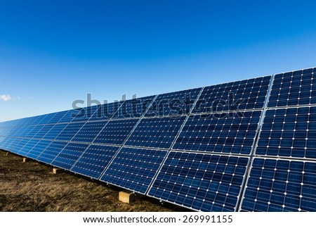 Photovoltaic solar panels installation and blue sky