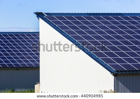 Photovoltaic Solar Panels on big agricultural warehouses - stock photo
