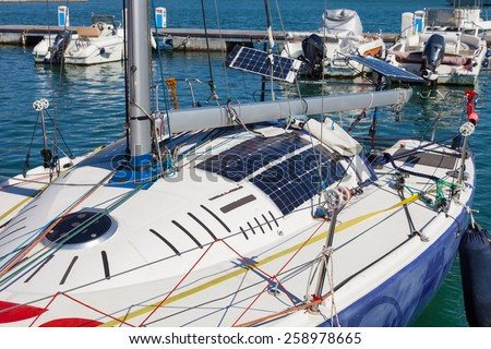 photovoltaic solar panels on modern sail boat - stock photo