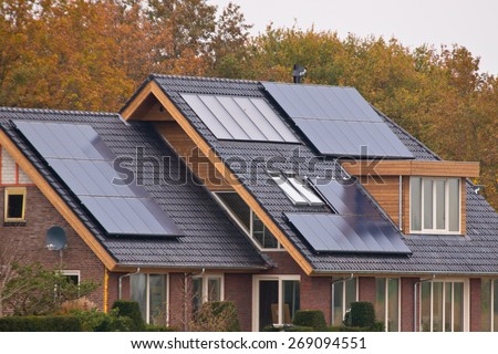 Photovoltaic Solar Panels on Newly Built Modern House - stock photo