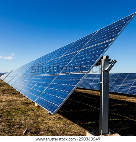 Photovoltaic solar panels on the field - stock photo