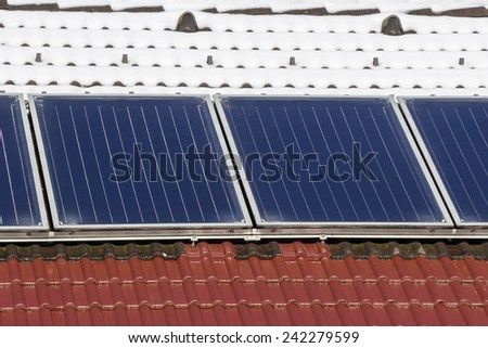 Photovoltaic Solar Panels on the roof House - stock photo