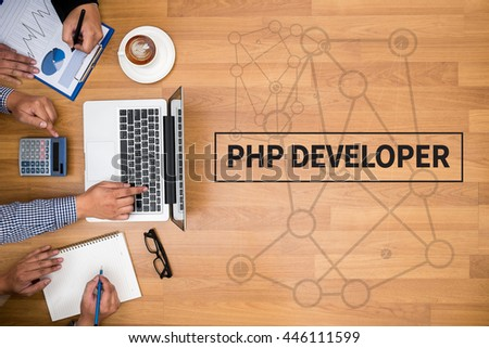 PHP DEVELOPER Business team hands at work with financial reports and a laptop - stock photo