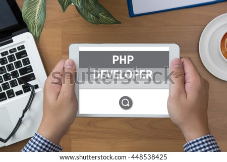 PHP DEVELOPER man hand Tablet and coffee cup - stock photo
