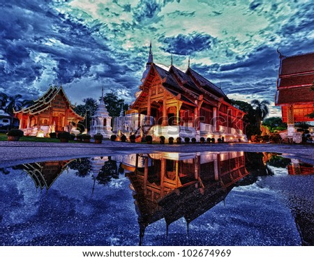 Phra Singh temple twilight time Viharn Lai Kam Wat Phra Singh is located in the western part of the old city centre of Chiang Mai. - stock photo
