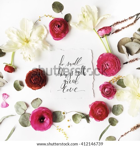 "Phrase ""Do small things with great love"" written in calligraphy style on paper with pink, red roses, ranunculus,   white flowers and green leaves isolated on white background. Flat lay, top view - stock photo"