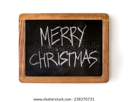 Phrase 'Merry Christmas' written with chalk on a blackboard. - stock photo