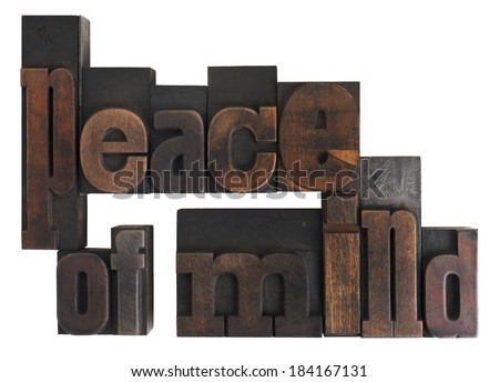 phrase peace of mind written in vintage wooden letterpress type, scratched and stained, isolated on white - stock photo