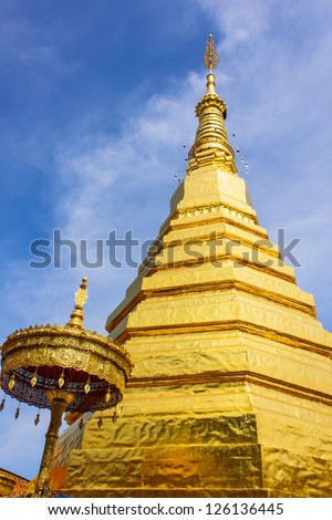 PHRATHAT CHOHAE TEMPLE in Phrae(Thailand) with blue sky - stock photo