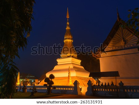 Phrathat KhamKaen - the 17th Century buddhist pagoda at Wat Chetiyaphumin,KhonKaen,Thailand.  They are public domain or treasure of Buddhism, no restrict in copy or use. - stock photo