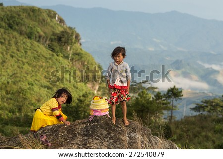 PHU CHI FA - OCT 27 : Hilltribe child in traditional clothing at one of the highest most famous points in the Thai Highlands of Chiang Rai in Phu Chi Fa Mountain on October 27th 2014 - stock photo