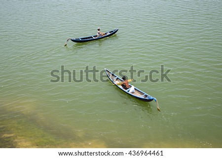 Phu Yen, Viet Nam - March 31, 2016: Young man on a wooden boat : rowing fisherman in Vietnam