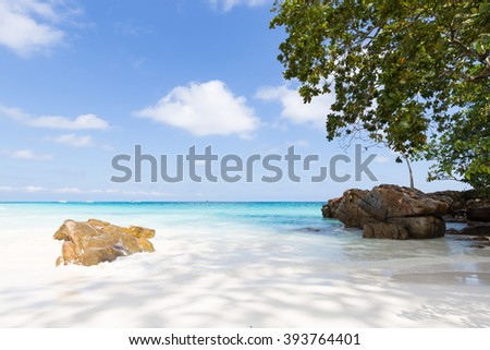 Phuket beach, rocks, sea and skies during the day with hot air. - stock photo