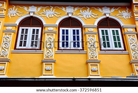 Phuket City, Thailand - January 8, 2011:  Ornate facade of a restored late 19th century Sino-Portuguese Chinese shop house on Soi Rommanee