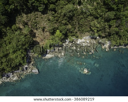 Phuket coastal view from above with jungle and emerald sea in Thailand - stock photo