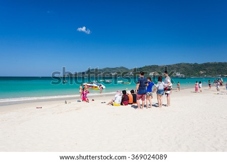 Phuket January 9, 2016 : The unidentified people are relaxing on Patong beach during a sunny day in Phuket, Thailand. Patong is one of famous beach located in the west coast of Phuket island.