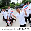 PHUKET - SEPTEMBER 16: unidentified students during a parade marking the birthday of monk  Luang Pu Supha who is 114 on September 16, 2010 in Phuket, Thailand. Many Thais believe he is the world's oldest man. - stock photo