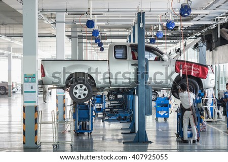 PHUKET, THAILAND - APRIL 19 : Car technician repairing car in workshop service station in Phuket on March 19, 2016. The official dealer of Toyota, who is the top market share for commercial car. - stock photo