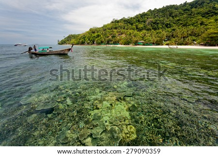 PHUKET, THAILAND - APRIL 15, 2008: Tourist visit the islands off Phuket and explore the coral reefs and snorkel in the shallow waters. Tourism is an important industry in Phuket, Thailand. - stock photo